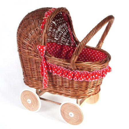 Poppenwagen riet, inclusief dekje en bekleding rood met hartjes.